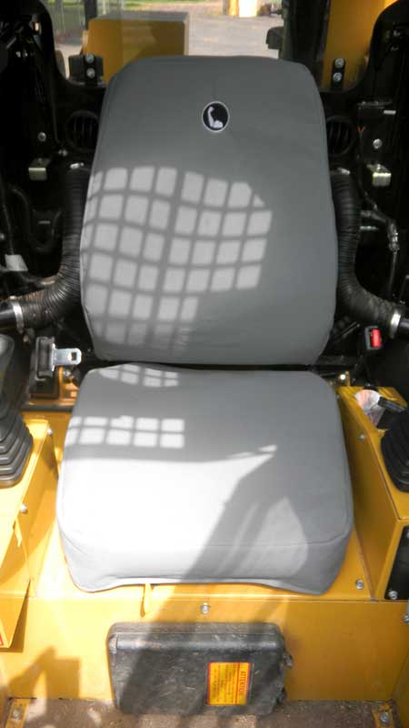 Tuffnuts canvas seat cover for cat earthmoving skid steer